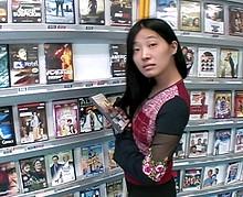 Jeune asiatique baisée lors d'une séance photos